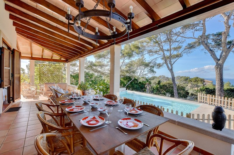 Villa Enderrocat with sea views, garden, lounge areas, and pool, holiday rental in Puig de Ros