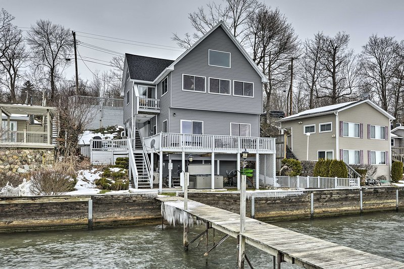 This stunning vacation rental features a dock and boat hoist.