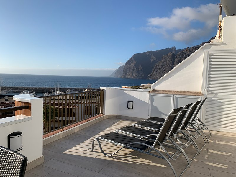 tumbonas para tomar el sol en la terraza