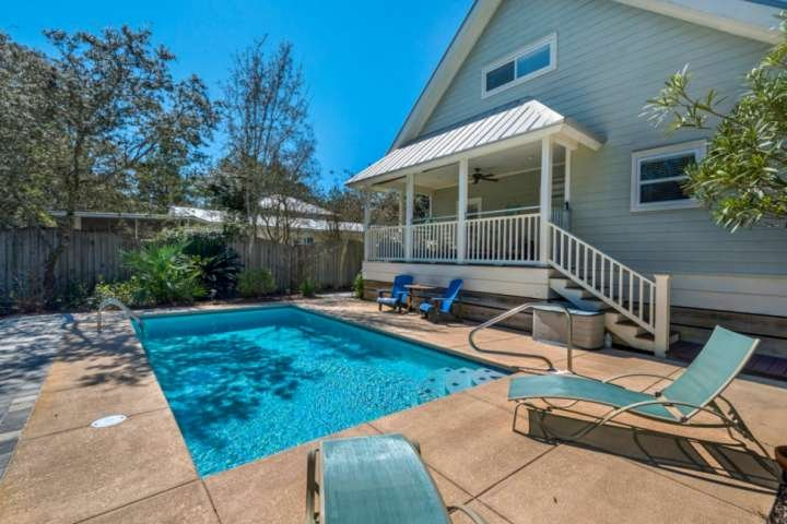 Large fenced in backyard, with a swimming pool that can be heated!