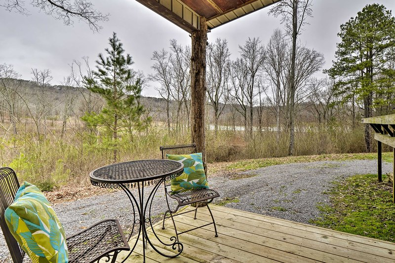 Enjoy the fresh air on the front porch of this Scottsboro home.
