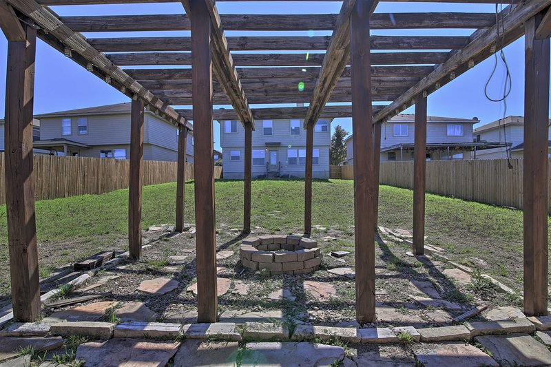 Out back, relax under the pergola and light a fire in the fire pit.