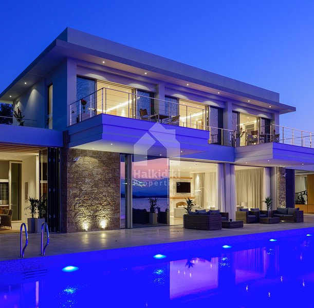 Beachfront Villa Natalia with Two Private Pools, holiday rental in Vourvourou