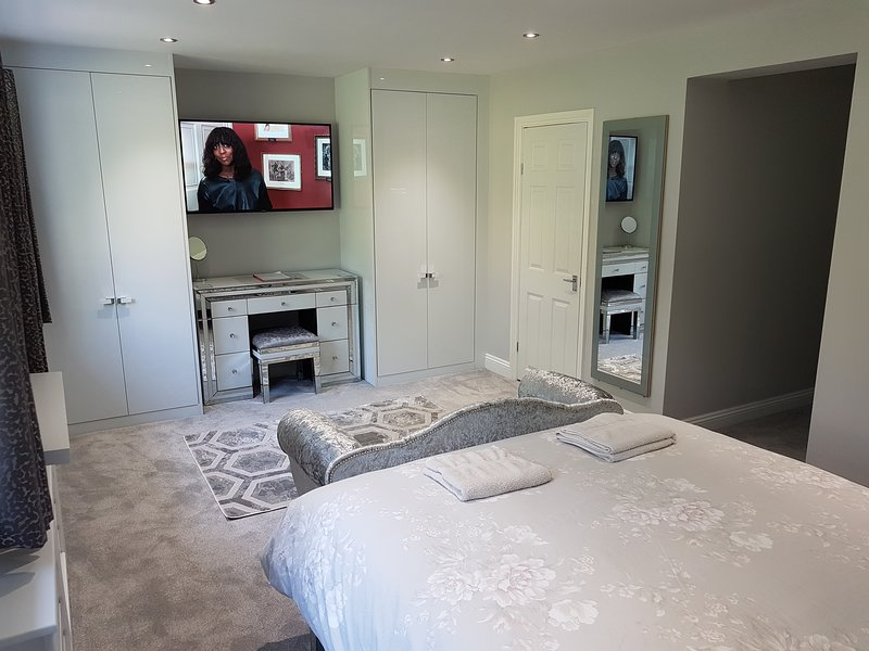 50' TV, double wardrobes, Private En-suite, hand made 2 seater sofa, Amazon echo, Dimmable lighting