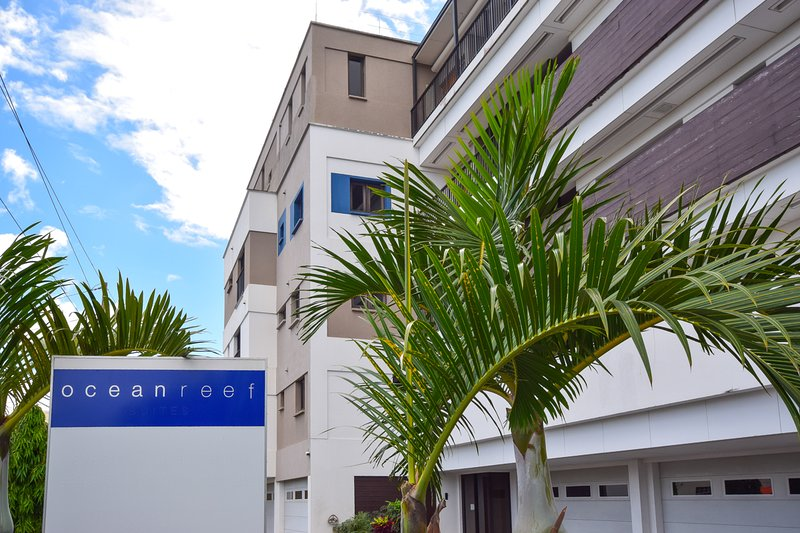 Street view of Ocean Reef. The building has a security gate and keypad entrance