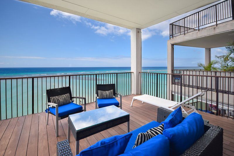 Relax in your private patio and take in the beach and ocean views from this modern condo