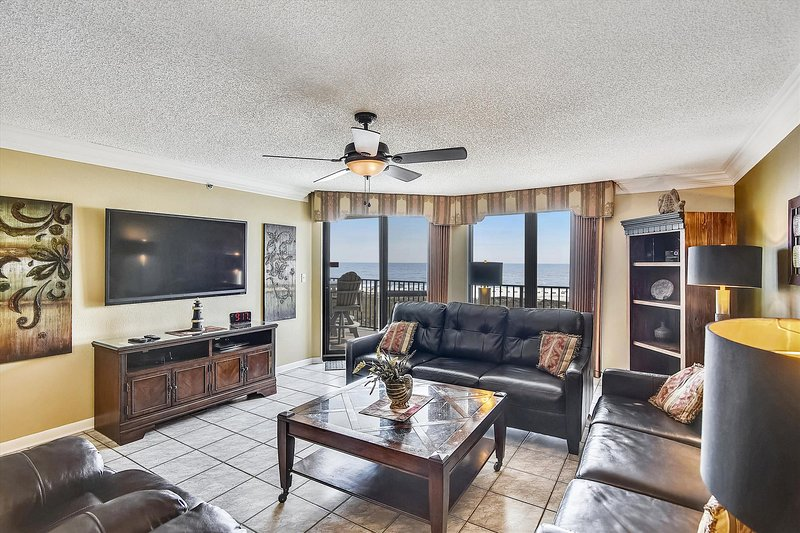 Spacious Living Room with New Furniture offers Comfortable Seating, Beachfront Views and Balcony Access