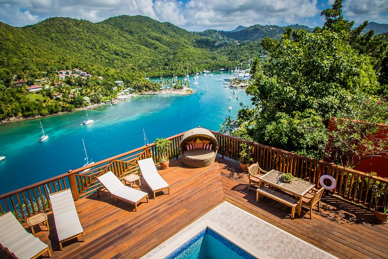 Looking down on pool deck and the entire length of Marigot Bay from the second-floor veranda deck.