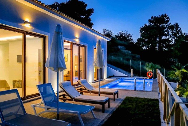 Beach front location, 2 bedrooms, 2 bathrooms, great views, AC, Free WiFi, location de vacances à Agios Sostis