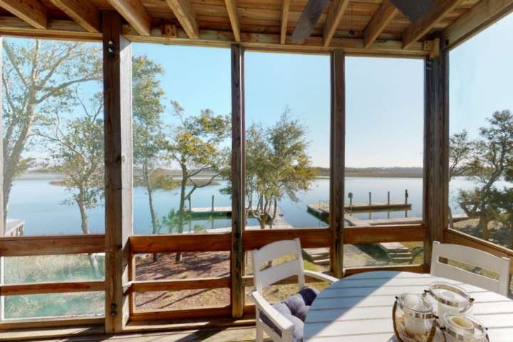 Marsh Mellow has plenty of room on the screened in porch for the entire family to enjoy morning coffee and watch the sunrise.