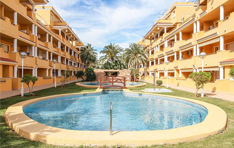 Amazing apartment in Dénia with Outdoor swimming pool, WiFi and 3 Bedrooms (EBI, holiday rental in Adsubia