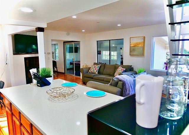 Kitchen counter has plenty of space to serve food buffet style.