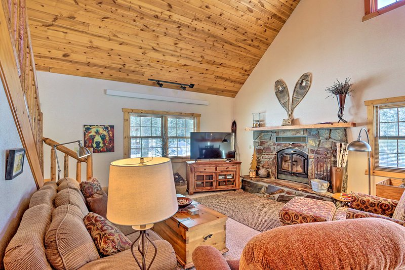 Gather your loved ones around the fire at this vacation rental for a cozy night.