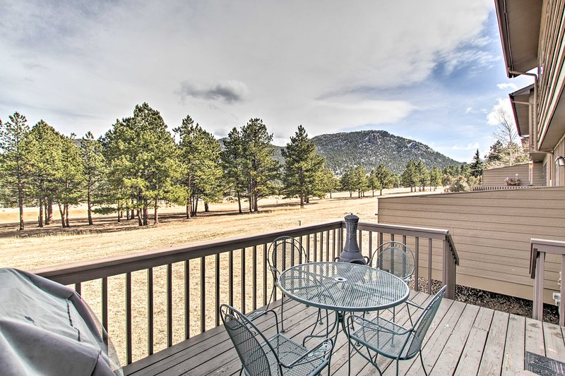 The 2-story vacation rental boasts a private balcony for mountain-view BBQs.