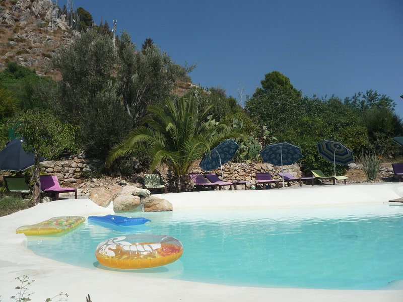 The natural lake-shaped pool in the middle of the Mediterranean garden,ideal for relax and playing