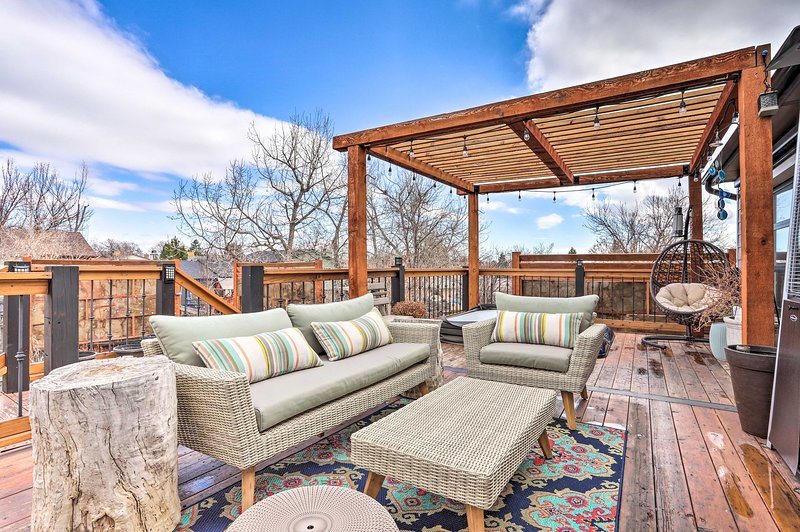 The vacation rental home features a furnished deck, among other amenities.