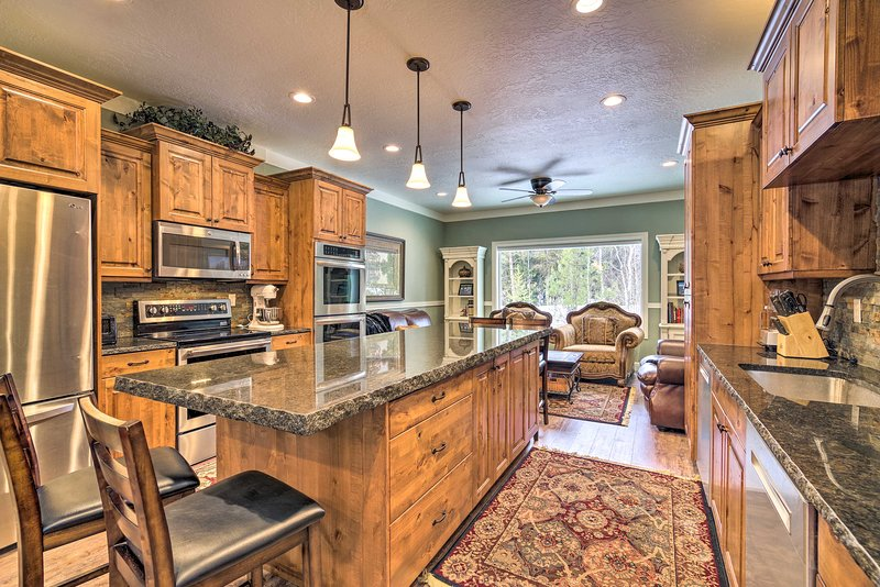 This vacation rental has a large, stainless steel kitchen with 3 ovens.