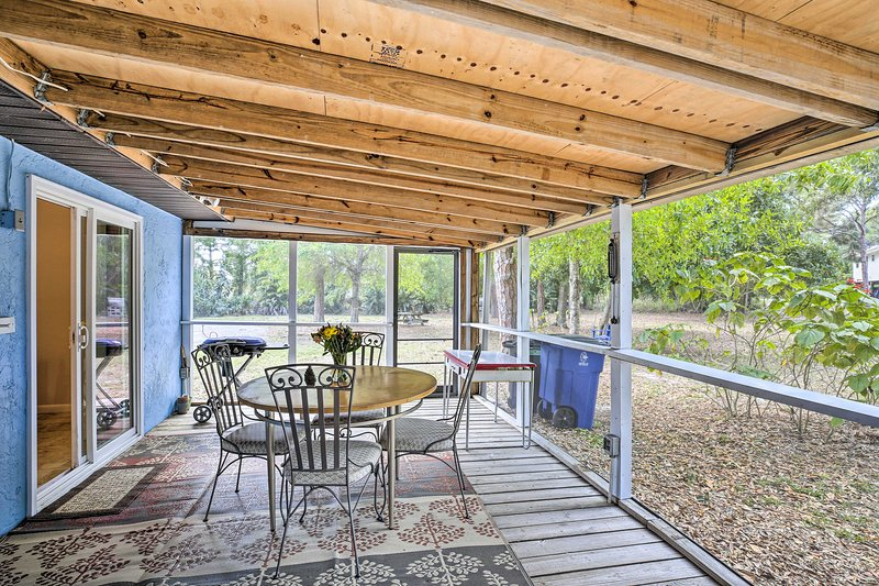 The screened porch is the perfect place to dine!