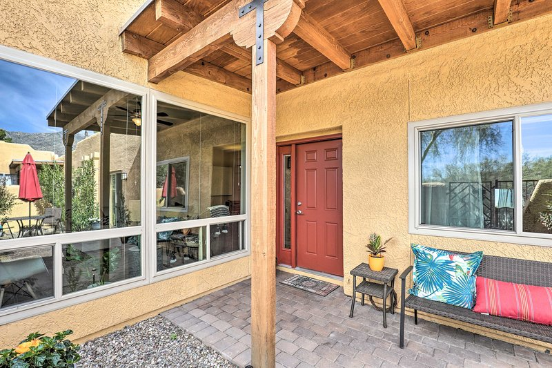 The townhome has a charming covered patio area for sipping morning coffee.