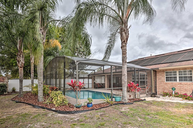 This Deltona vacation rental house boasts a private yard and outdoor oasis!