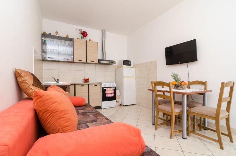Apartments Mamma Mia - Comfort One Bedroom Apartment with Terrace, location de vacances à Srebreno