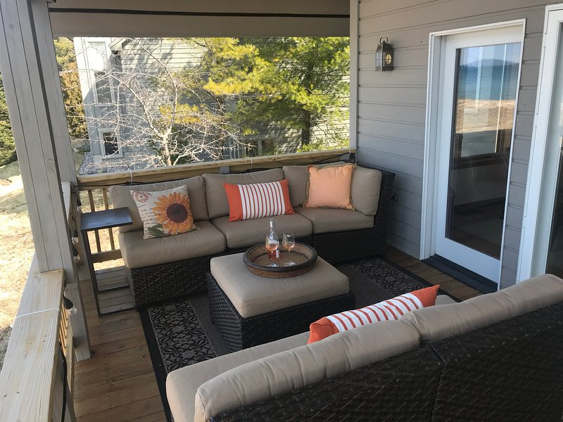 Deck with amazing views, plenty of seating and pull down shades