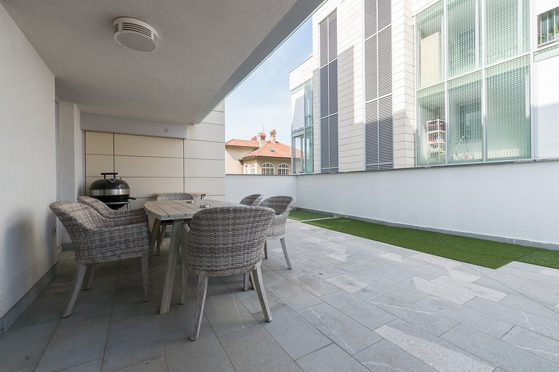 Modern apartment with big terrace & private garage, holiday rental in Ljubljana