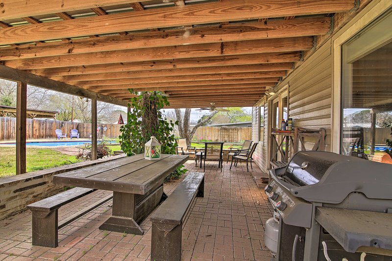 This vacation rental features a private and peaceful backyard with a pool.