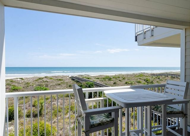 Enjoy beautiful views from this oceanfront condo located by community pool, holiday rental in Ogden