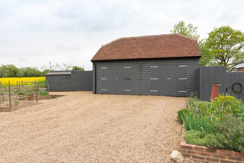 The drive, parking is outside the left garage, private entrance to garden is left of garage