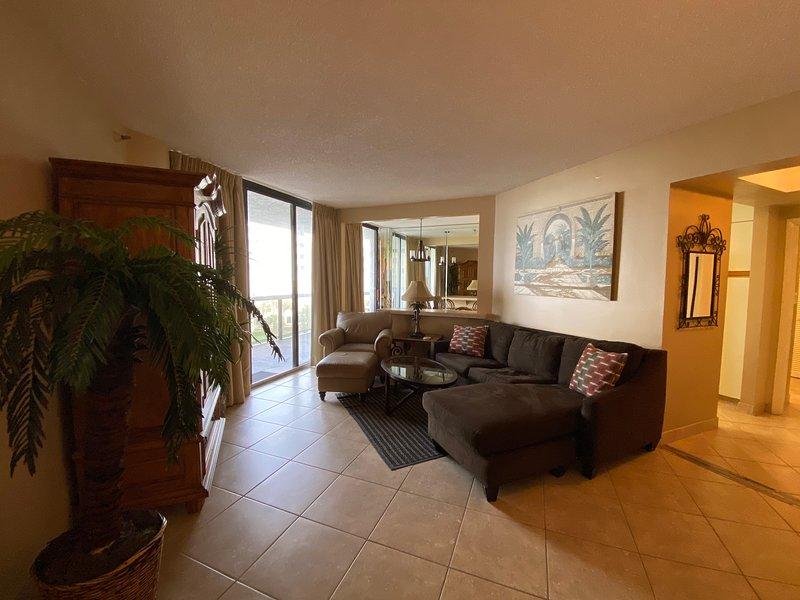 Enjoy our spacious living room perfectly located next to the kitchen and balcony entrance!