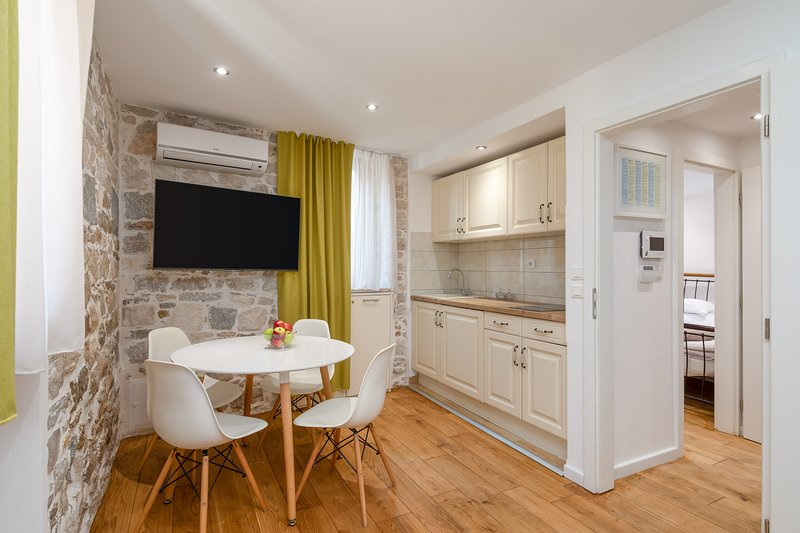 Kitchen, dining area and TV