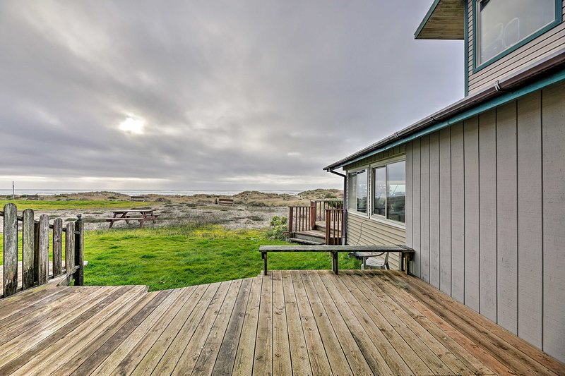 Step onto the deck of this vacation rental and take in the ocean views.