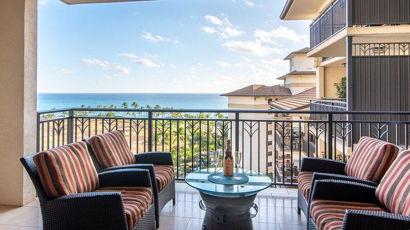 Balcony with Ocean View, Outdoor Seating Set, and Coffee Table.