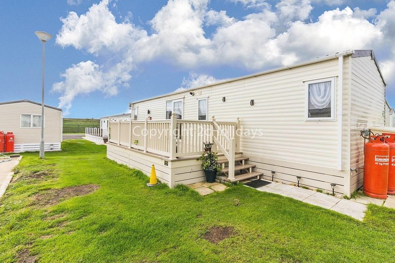 A very modern design and luxury mobile home in a brilliant location close to sea front and beach access.