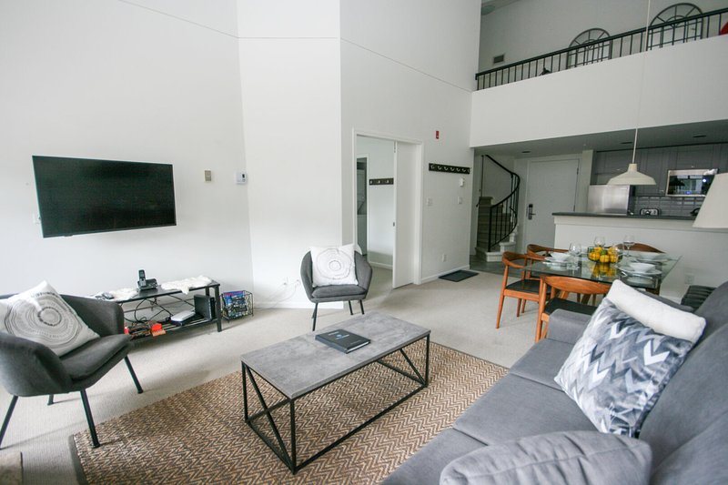 Living area w/ sofa bed and smart Tv