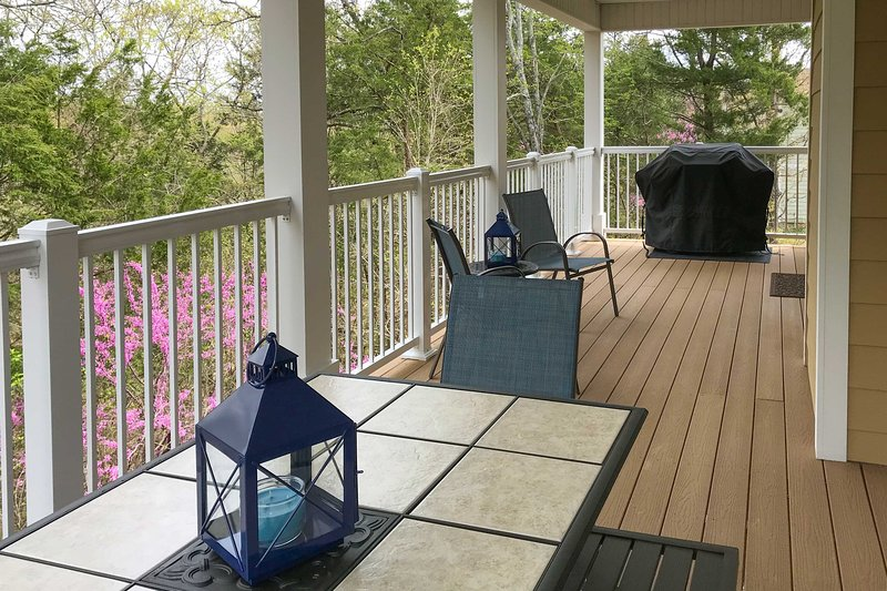 Enjoy time with loved ones on this vacation rental's private deck.