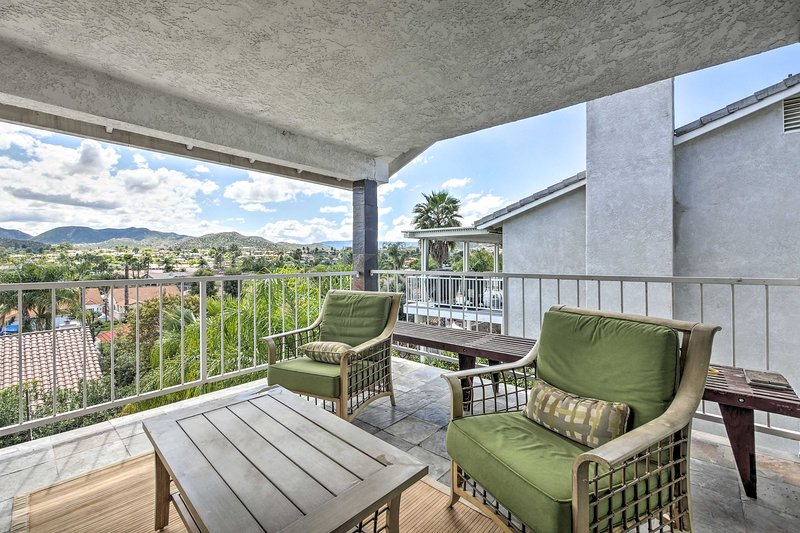 Take in the Cali views from the balcony's luxury outdoor furniture.