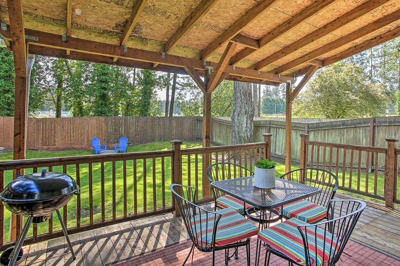 This townhome boasts outdoor amenities including a deck and fire pit.