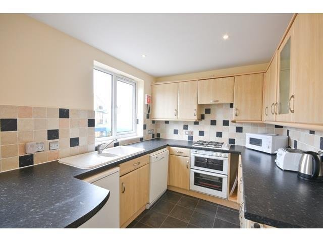 Kitchen with breakfast bar with balcony overlooking the Marina