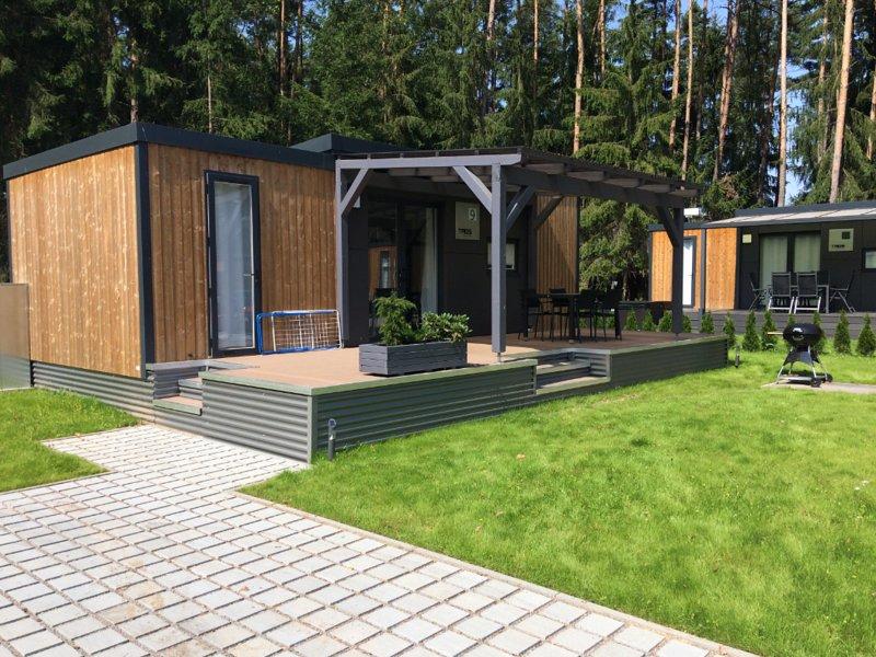Modernes Mobilheim am See mit Fass-Sauna (WA104), holiday rental in Zeitlarn