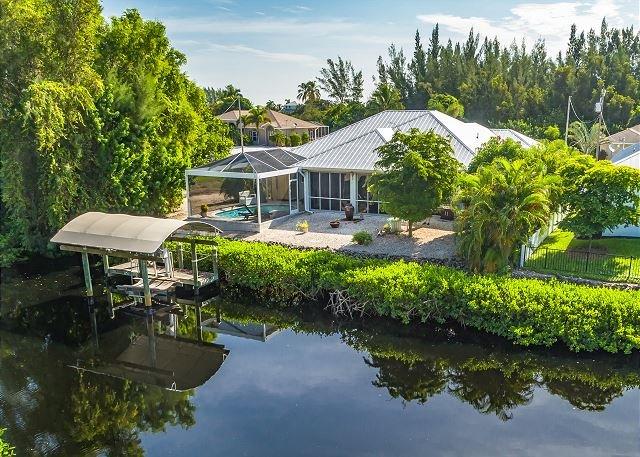 Bokeelia Breeze w/ Private Pool, Boat Dock & Enclosed Lanai, vacation rental in Bokeelia