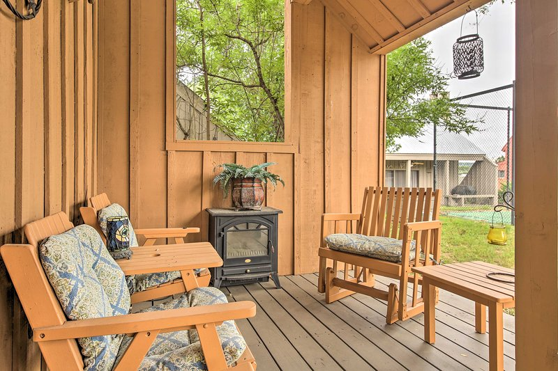 After a day on Lake Travis, lounge on the vacation rental's covered deck.