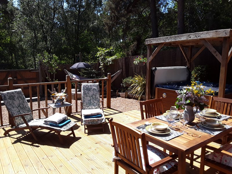 Relax and dine on the decking. 4 recliners available when 4 guests stay