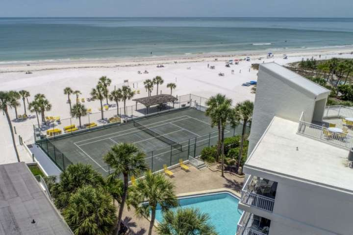 Complex heated pool and private tennis court all overlooking Crescent Beach. (complex aerial view)