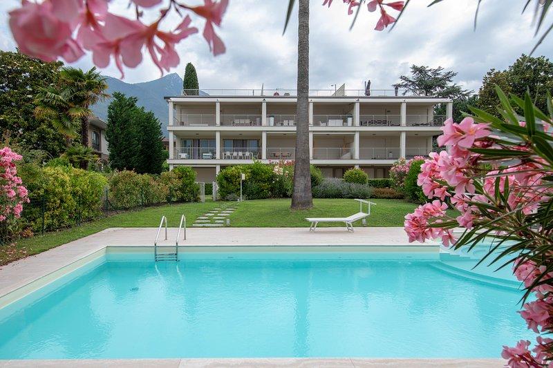 Appartamento al lago per una vacanza eco-friendly. Piscina, giardino, parcheggio, casa vacanza a Maderno