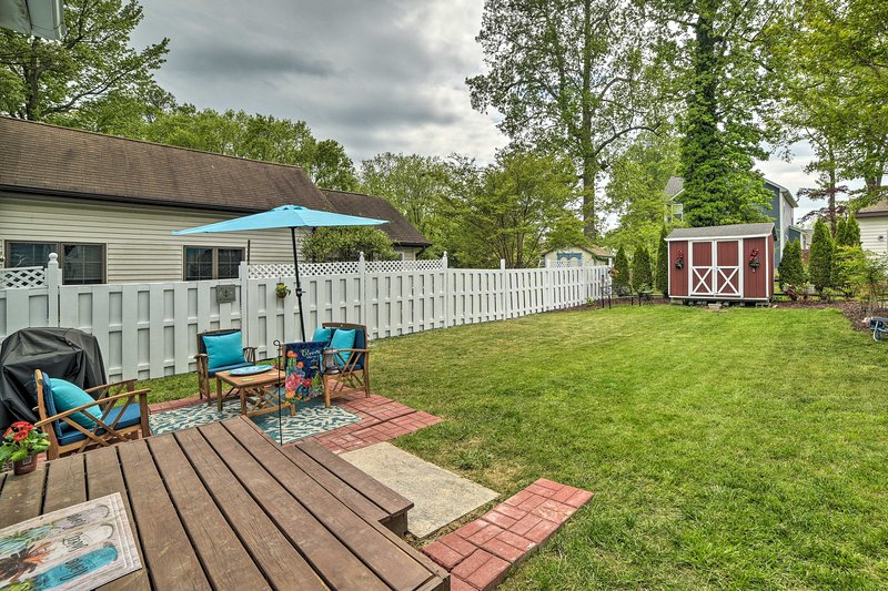 Your pet can run wild in this cottage's fenced-in backyard.