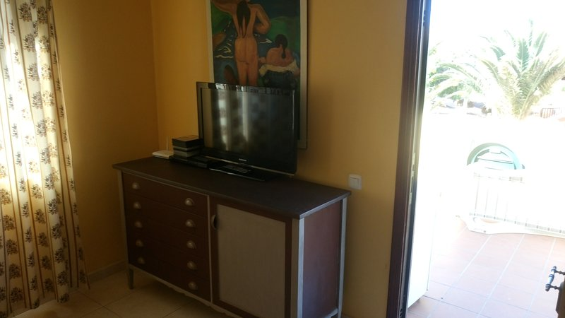 Entertainment area with TV with USB and HDMI connections, DVD player and also WI-FI,