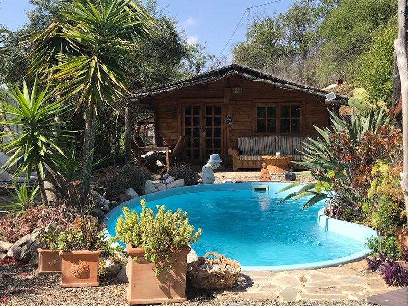 Ideal for a couple Peaceful/Romantic Wooden Cabin with Pool & private gardens, holiday rental in Monda