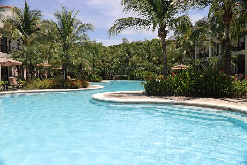 Luxury Pacifico Lifestyle Ground Floor Condo with Direct Pool Access! L-1204, holiday rental in Artola
